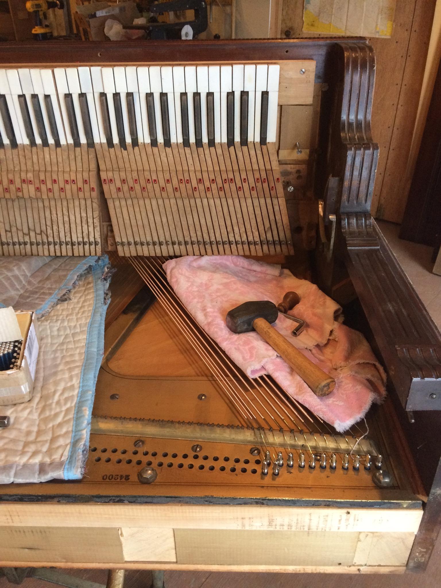 Richmond upright bass string installation